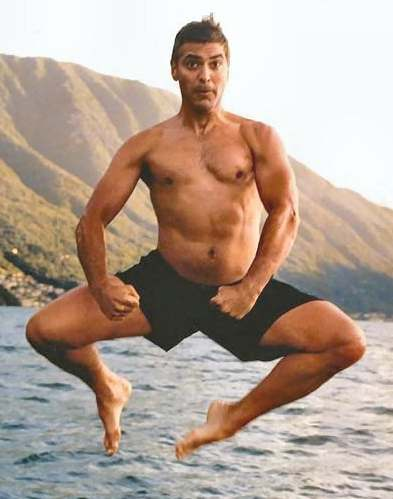 george_clooney_swimming_mid_air_jump1